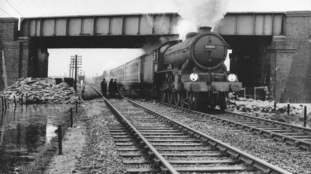 A steam train goes under the bridge at Yarmouth's Southtown Station in 1953. Photo: Archant Library