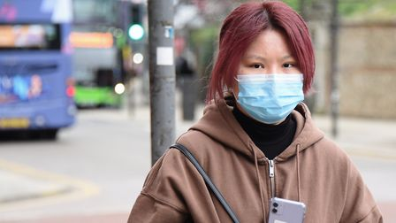 A pedestrian wearing a face mask. Picture: DENISE BRADLEY