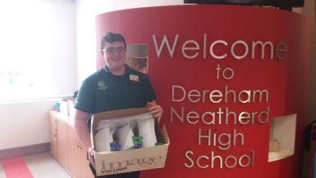 Adam Crowhurst, a year 11 pupil and worker at Morrisons, takes our newly made supply of face shields