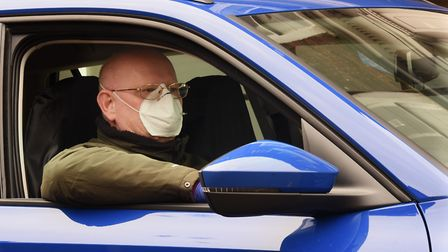 A taxi driver in Dereham wears a face mask amid lockdown due to coronavirus. Picture: Denise Bradley