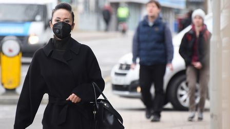A pedestrian wearing a face mask in Norwich amid the coronavirus pandemic. Picture: Denise Bradley