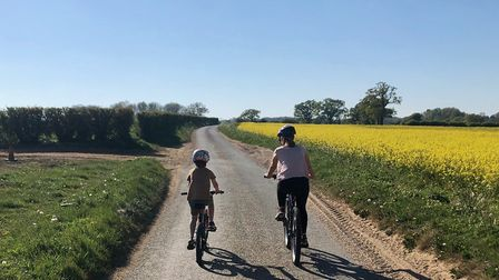 Oscar Bunko, 7, is raising money for Friends of Hingham School by cycling the equivalent distance fr