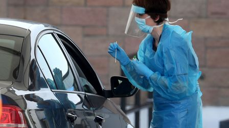A nurse prepares to take a sample at a COVID 19 testing centre. Pic: Andrew Milligan/PA Wire