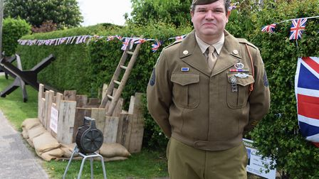Mark Bailey at his home in Attleborough, with his tribute to VE Day, which includes tank defences kn