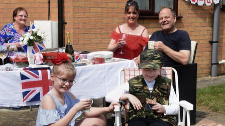 Families enjoying the VE Day Keep Calm and Celebrate street party in Snowdrop Drive, Attleborough, a