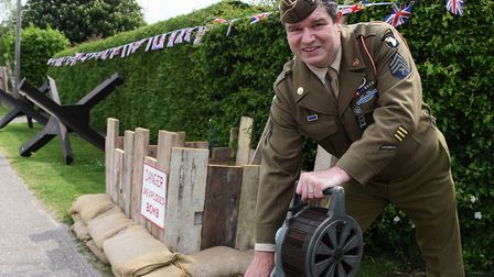 Mark Bailey at his home in Attleborough, with his tribute to VE Day, which includes an air raid sire