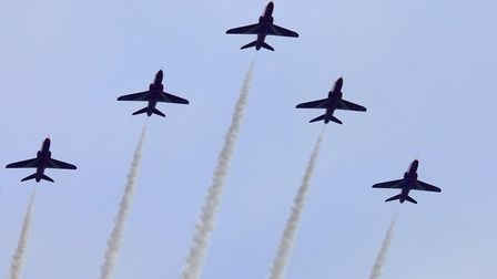 The Red Arrows in formation over Toftwood. Picture Jon Gibson