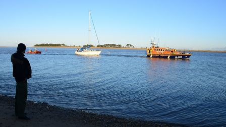 Wells Lifeboat crews two the yacht back into Wells Harbour. Picture: Ray West