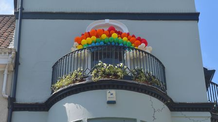 Norwich city centre during lockdown. Rainbow balloons on display in the Sir Garnet pub Picture: BRIT