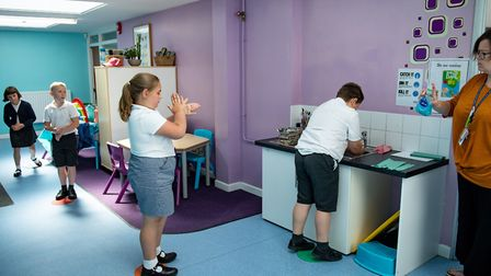Children abide by a traffic light system for social distancing when washing their hands. Primary pup