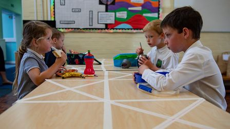 Children eat lunch in segregated positions due to social distancing measures. Picture: Jacob King/PA