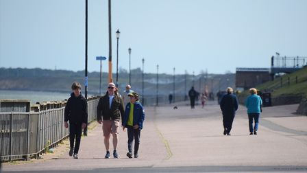 People on the promenade at Gorleston beach in the summery weather as the lockdown exercise restricti