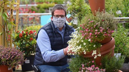 General manager Julian Chittock wears a face mask at Thetford Garden Centre after coronavirus measur