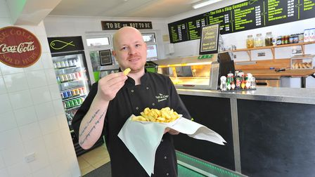 Jason Fish, who owns and runs the Jason's Fish and Chips in Rackheath. The chippy has reopened durin