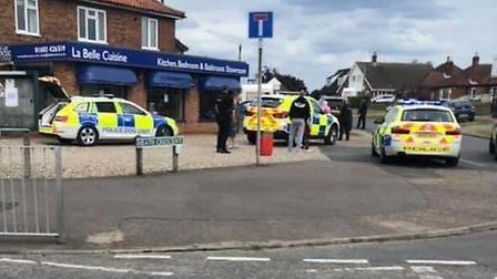 Three police cars on the scene on the corner of Cromer Road and Heath Crescent in Norwich, where two