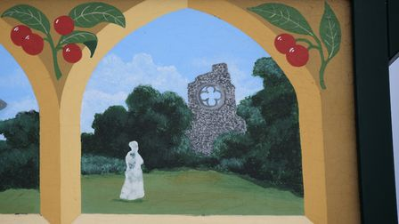The ghostly figure of nun Sister Barbara by the Abbey ruins features on one of the Marham village si