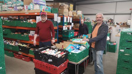 Volunteers at Norwich foodbank pack food parcels, more families are recieving parcels than before co