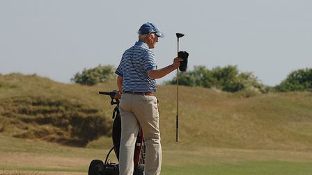 Retired engineer David Tate, 77, was out on the links at Old Hunstanton on the hottest day of the ye