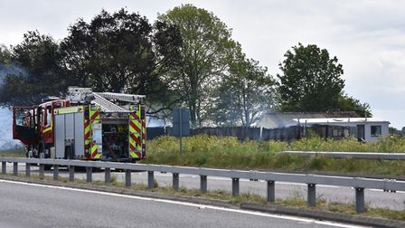 A barn fire next to Tolhouse cottage on Lowestoft Road burt into flames, temporarily closing the A47