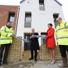 Mike Stonard, chairman of the Norwich Regeneration Company, cuts the ribbon to open the first of the