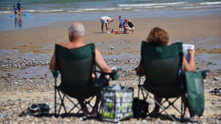 People will be enjoying the bank holiday sunshine on Cromer beach but are being urged to observe soc