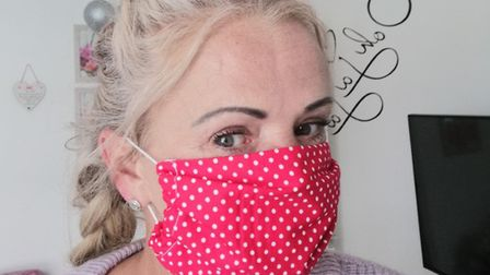 Annie Reilly wearing one of the hundeds of face masks she has made during the coronavirus lockdown.