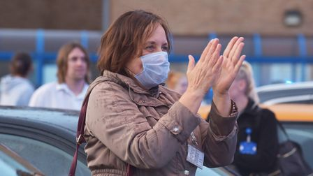 Pictures from the Lock Down 2020. A lady taking part in Clap for Carers Pictures: BRITTANY WOODMAN