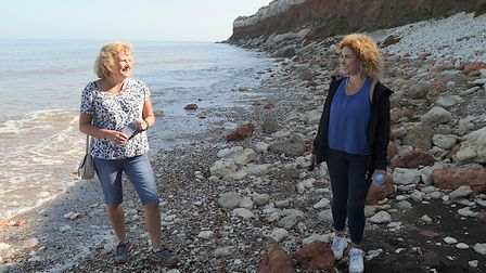 Counsellor Amanda Goss (right) is now taking her clients on beach walks because she can't socially d