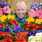 Philip Morter of Corners with some primroses, to launch the charities support scheme, in which the g