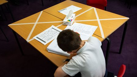 Social distancing measures as a child studies on a marked table at school. Rachel Moore says since t