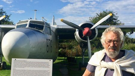 Rod Clark, at the Norfolk and Suffolk Air Museum at Flixton, in front of a type of plane he worked o