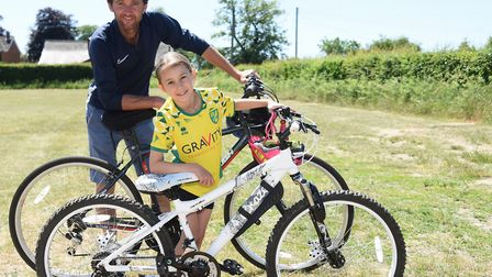 Eight-year-old Jemima Howe who has cycled to raise money for Banham Zoo and Africa Alive! with her d