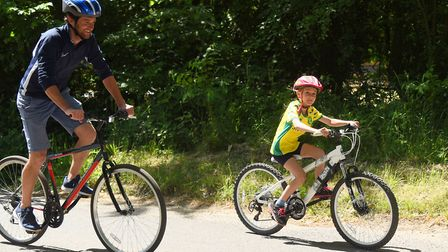 Eight-year-old Jemima Howe who has cycled to raise money for Banham Zoo and Africa Alive! with dad E