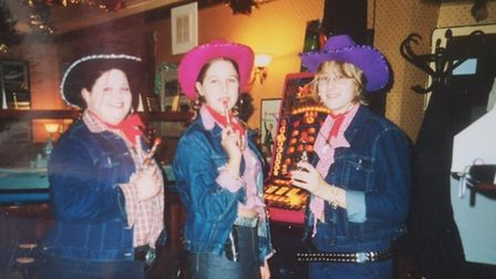 From left, Jemma Thake, and waitresses Melissa Jagger and Michelle Ashby, and the Ark Royal pub in W