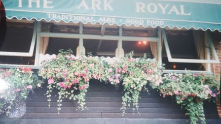 Flower baskets hanging from the windows of the Ark Royal pub in Wells, in times gone by. Picture: Su