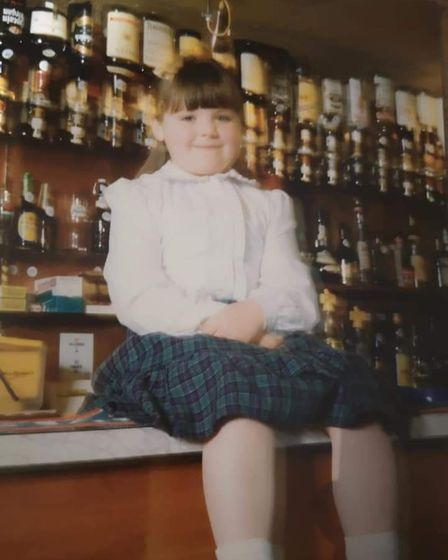 Jemma Thake, sitting on the bar of the Ark Royal pub in Wells, in around 1989. Picture: Supplied by