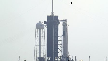 The SpaceX Falcon 9, with the Crew Dragon spacecraft on top of the rocket, sits on Launch Pad 39-A a