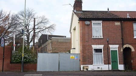 The empty plot (behind the metal fence) where Neil Harrison's end of terrace house on Finkelgate col