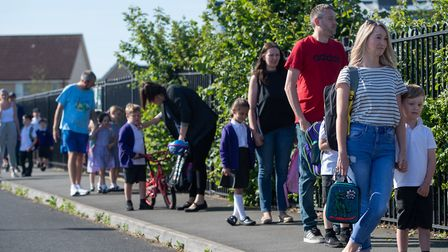 Parents drop off pupils at Queen's Hill Primary School in Costessey as pupils in reception, year one