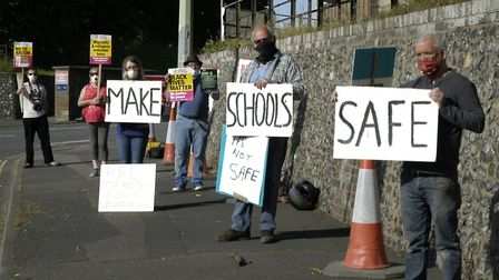 Teachers, parents and carers protest outside of County Hall in Norwich on June 1 against the reopeni
