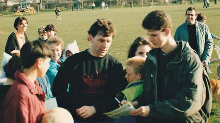 Manchester United captain Bryan Robson signs autographs for gathered fans in Hethersett. Picture: Ma