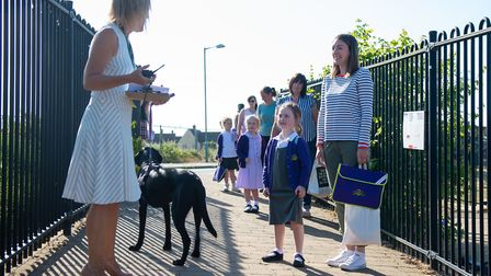 Parents observe social distancing rules as they drop off pupils at Queen's Hill Primary School in Co