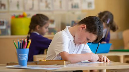 Reception pupil Finley in class at Queen's Hill Primary School in Costessey. Picture: Joe Giddens/PA