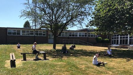 Pupils at St Williams Primary in Thorpe St Andrew space out in a small group during an outdoor art c