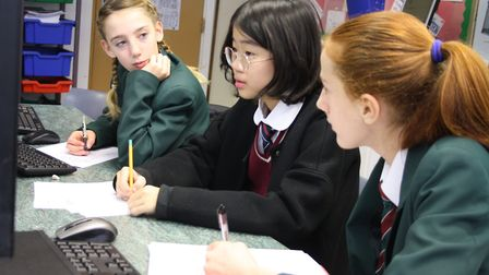 A Chinese student with pupils at Reepham High School and College as part of a visit in 2019. GCSE Ma