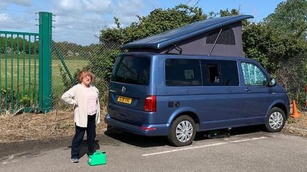 Ros McManus with her VW campervan at the back of the James Paget Hospital. Photo: Ros McManus