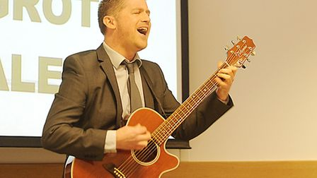 EDP Community Editor Chris Hill singing at Monday morning's Breckland Council planning meeting. Pict
