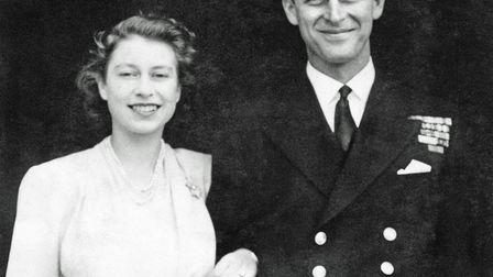 Princess Elizabeth and Lieutenant Philip Mountbatten posing for their engagement pictures at Bucking