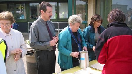 Carole Fields, serving drinks with Dominic Cragoe during a summer event at Sheringham Community Prim