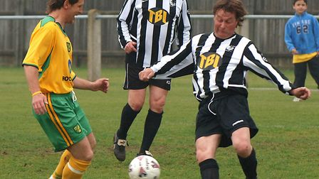 Darren Eadie for Norwich City All Stars in action against David Wilkins for Dereham All Stars and Jo